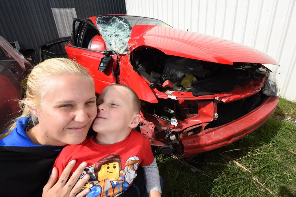Jessica Dhu with her five year-old son Rihan Jarrett who saved her life after waving down traffice after an accident. Photo Marc Stapelberg / The Northern Star