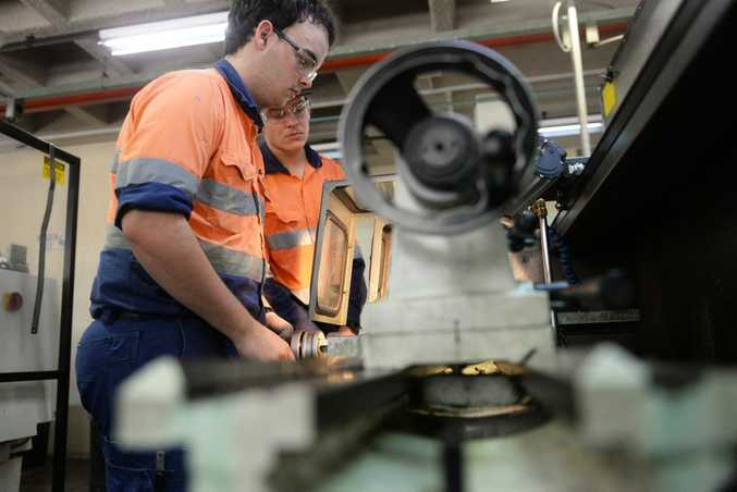 TAFE TRAINING: Apprentices Nick Wood and Bailey Huth on the lathe. Photo: Mike Knott / NewsMail