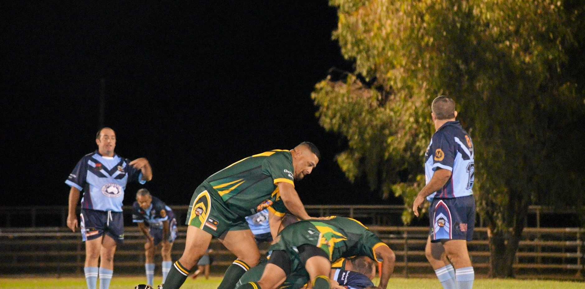 CHAMPIONS: Nathan Blacklock and John Hopoate tackle a Charleville team member at the Saturday night game of League of Legends.