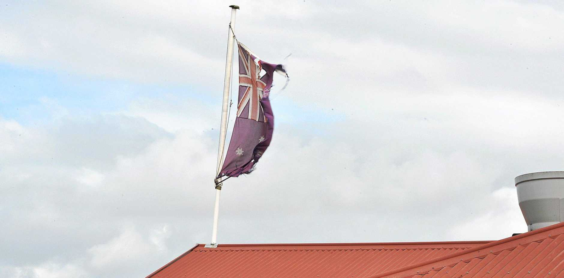 The disgraceful state of an Australian flag fluttering above the Brodies building is upsetting Gympie residents.