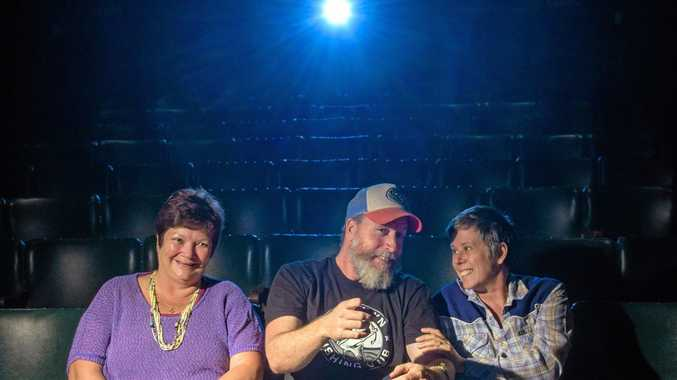 CURTAINS, LIGHTS: Bent Bridge Film Festival organisers Wendy Gibbs, Danny Loyden and Sammy Lovejoy get ready at the Pelican Playhouse for screenings this Sunday.