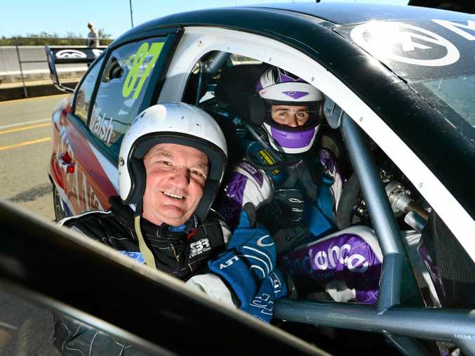 Mayor Paul Pisasale gets set for a hot lap in a V8 Supercar with Ipswich driver Ash Walsh. He has big plans for Qld Raceway.