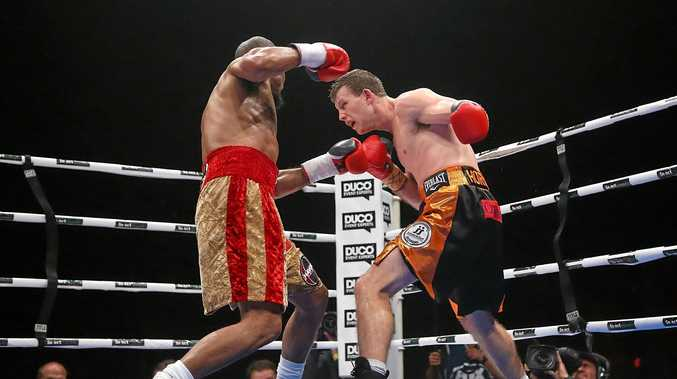 UP FOR THE FIGHT: Jeff Horn (right) punches Randall Bailey.