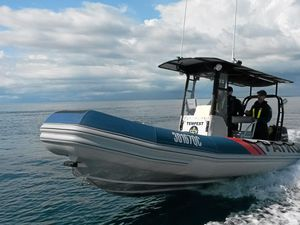 Boating patrol rescues four from capsized craft off Bribie Island