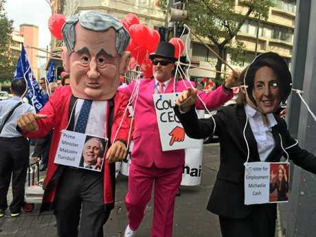Turnbull and Cash were targeted by angry protesters.