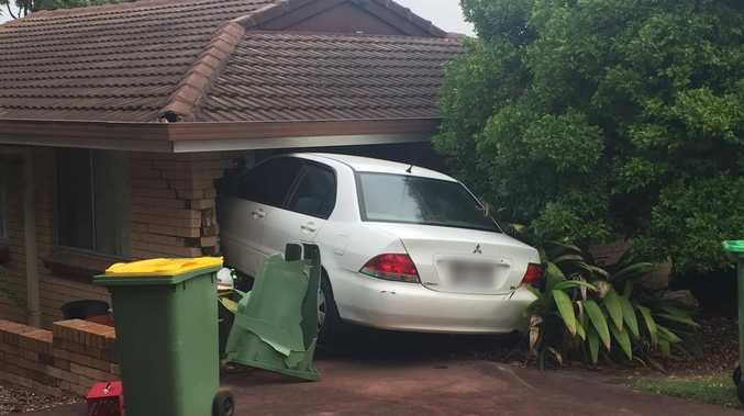 A car has ploughed into a Mt Lofty home. The driver escaped without injury.
