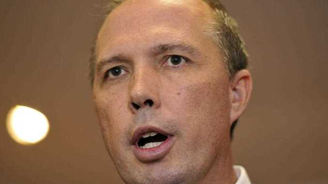 Minister for Immigration Peter Dutton speaks to the media in Sydney, Friday, April 29, 2016.