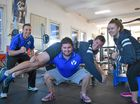 TEAM VOYAGE: Jaron Cumerford (left) and Maddie Thrift (right) urge on Tom Hardy as he lifts Nick Kemp.