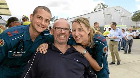 Bruce O'Grady with paramedics Chris Lloyd and Amanda Walsh at Bruce's workplace in Wulkuraka on Thursday.