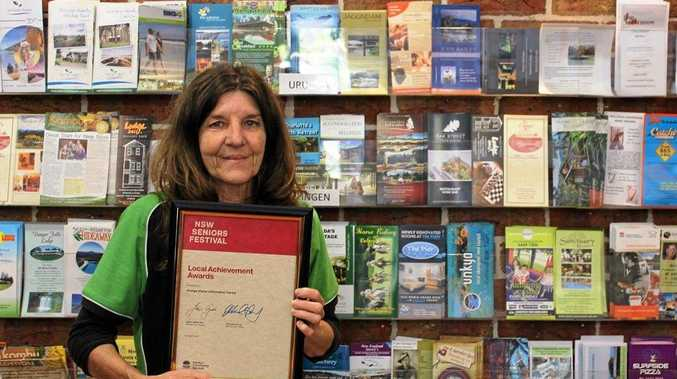 Dianne Rees with the award presented to the Urunga centre.