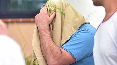 Glenn Brian Tidyman, 43, leaves Maroochydore Watch House after being granted bail on charges of common assault and entering a dwelling with intent by break at night using violence.