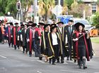 USQ graduation - graduates make their way along Lennox St from Maryborough City Hall to the Brolga Theatre. Photo: Alistair Brightman / Fraser Coast Chronicle
