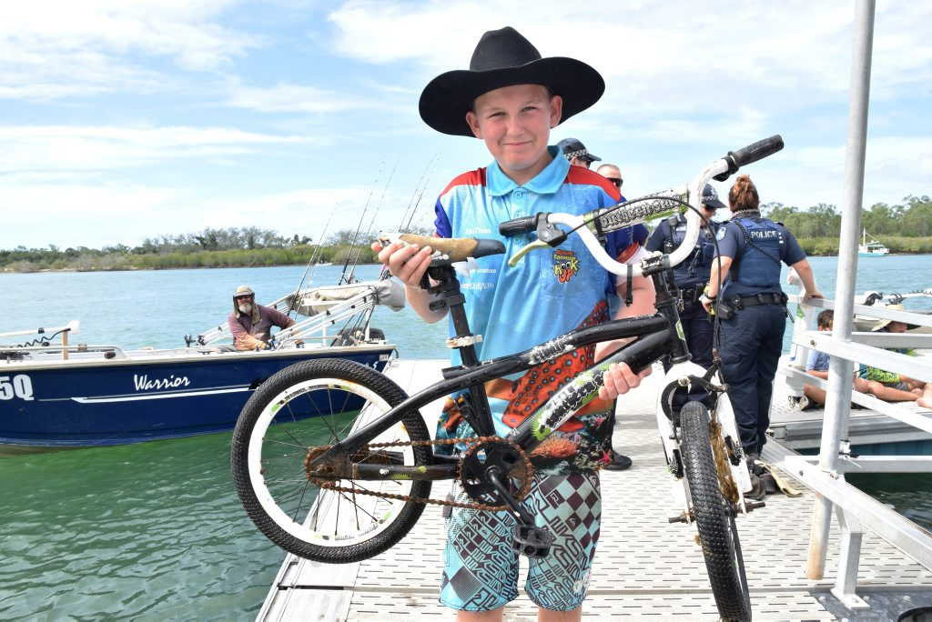 SURPRISE CATCH: Liam Coughlan came all the way from Gracemere to 'catch' this bike in the Boyne River -