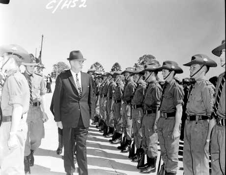 GROUP APPROACH: NSW Deputy Premier and Minister for Education Charles Cutler inspects the Casino High School cadet group at the grand opening of the school in 1965.