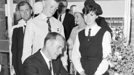 Casino High School students and staff watch on as NSW Deputy Premier Charles Cutler signs in during the grand opening of the school in 1965.