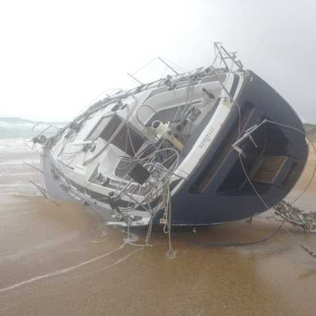 WASHED UP: The hull of an abandoned yacht Wooli residents found on the beach on Tuesday morning.