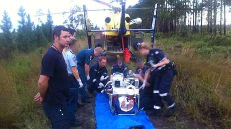 Paramedics treat a patient at Coochin Creek.