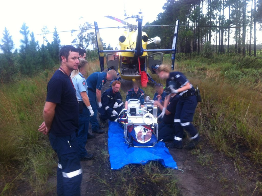 Paramedics treat a patient at Coochin Creek.