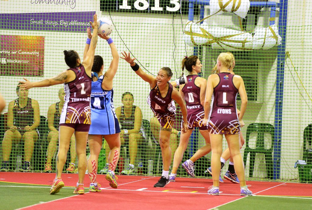 Queensland Heat's Janelle Tukaokao and Kate Piakura defend NSW Waratah's Eriin Coughlan in the 6-a-side over 30's ladies Grand Final. Queensland defeated the NSW Waratahs 48-31. Photo Lee Constable / Daily Mercury