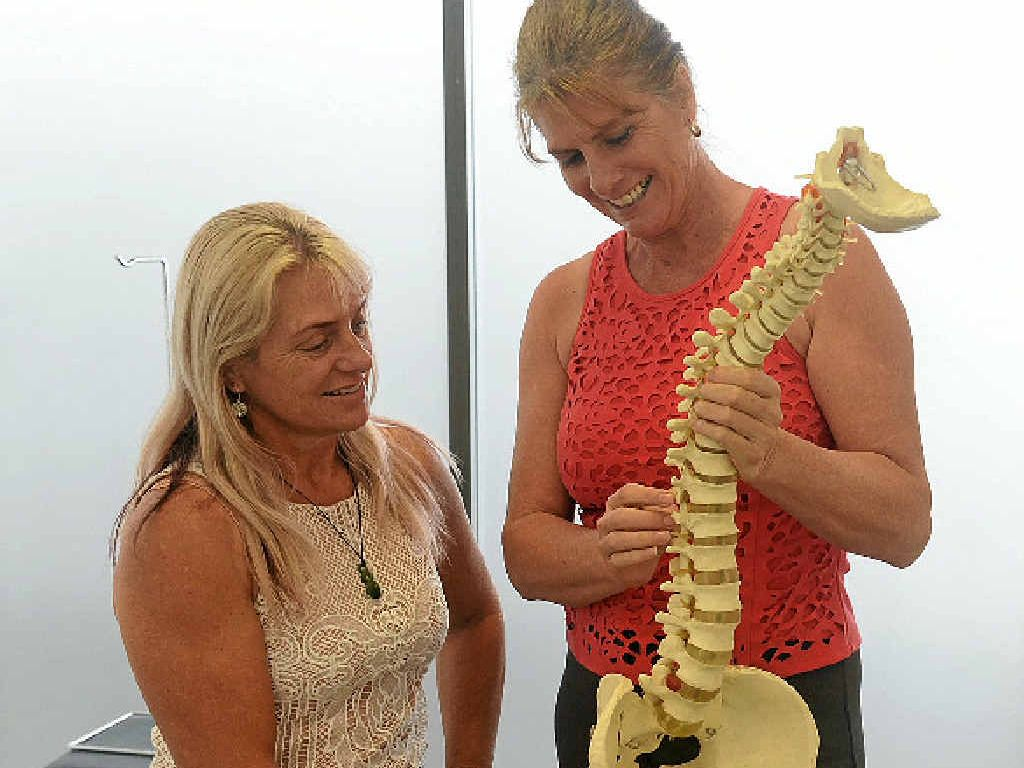 PASSIONATE ABOUT PEOPLE: Dr Denise Lindley of Bargara Family Chiropractic with client Judy Higgins.