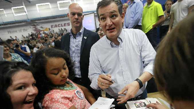 Republican presidential candidate Ted Cruz signs autographs at a campaign rally in Lafayette, Indiana.