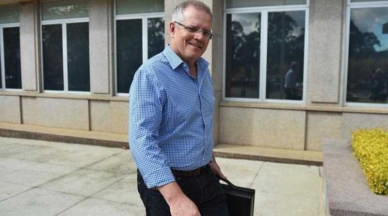 Treasurer Scott Morrison outside The Treasury as part of a media opportunity in Canberra, Saturday, April 30, 2016.