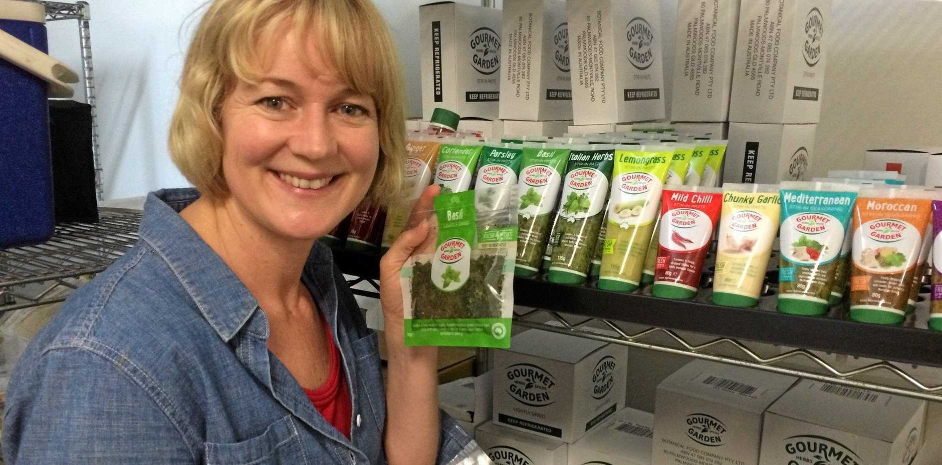 NEW ERA: Jacqui Wilson-Smith, of Gourmet Garden, with some of the locally produced herb products.