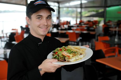 SEAFOOD SELECTION: Chef Luke Russell holding up a serving of the Bundy Barra at Grunske's by the River. Photo: Mike Knott / NewsMail