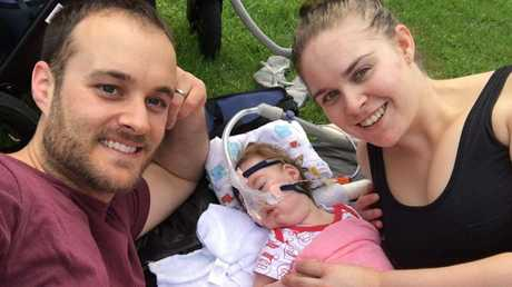 DAY OUT: Baby Zoe Grace Chisholm (centre) with parents Scott and Laura Chisholm on her first day out at Lake Annand Park in Toowoomba.
