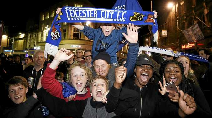 THE FANS GO CRAZY: Leicester City supporters celebrate their club's English Premier League title.