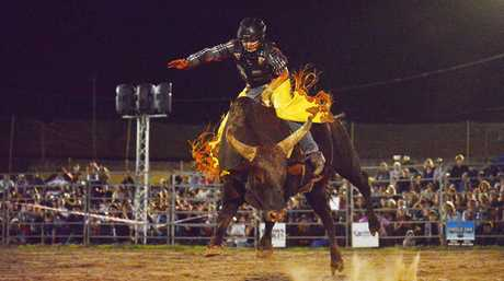 Luke Nichols riding Rap Dancer at the PBR Bullriding Rural Weekly Live Series held at the Grafton Showgrounds. Photo:Bruce Thomas / Daily Examiner March 28, 2015