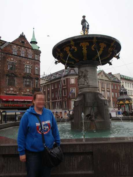 The woman appeared to be on a working holiday and is seen here in front of a statue. Photo Contributed