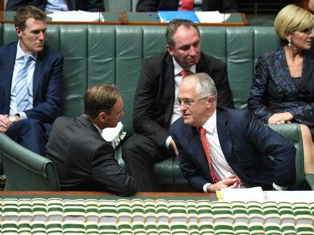 Australian Federal Environment minister Greg Hunt speaks with Australian Prime Minister Malcolm Turnbull (bottom right) during Question Time in the House of Representatives at Parliament House in Canberra, Tuesday, May 3, 2016.