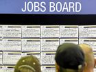 Job seekers read the job advertisements on large boards at the Ipswich Showgrounds where the Australian Government Jobs and Skills Expo was held today (140613). Photo: Claudia Baxter / The Queensland Times