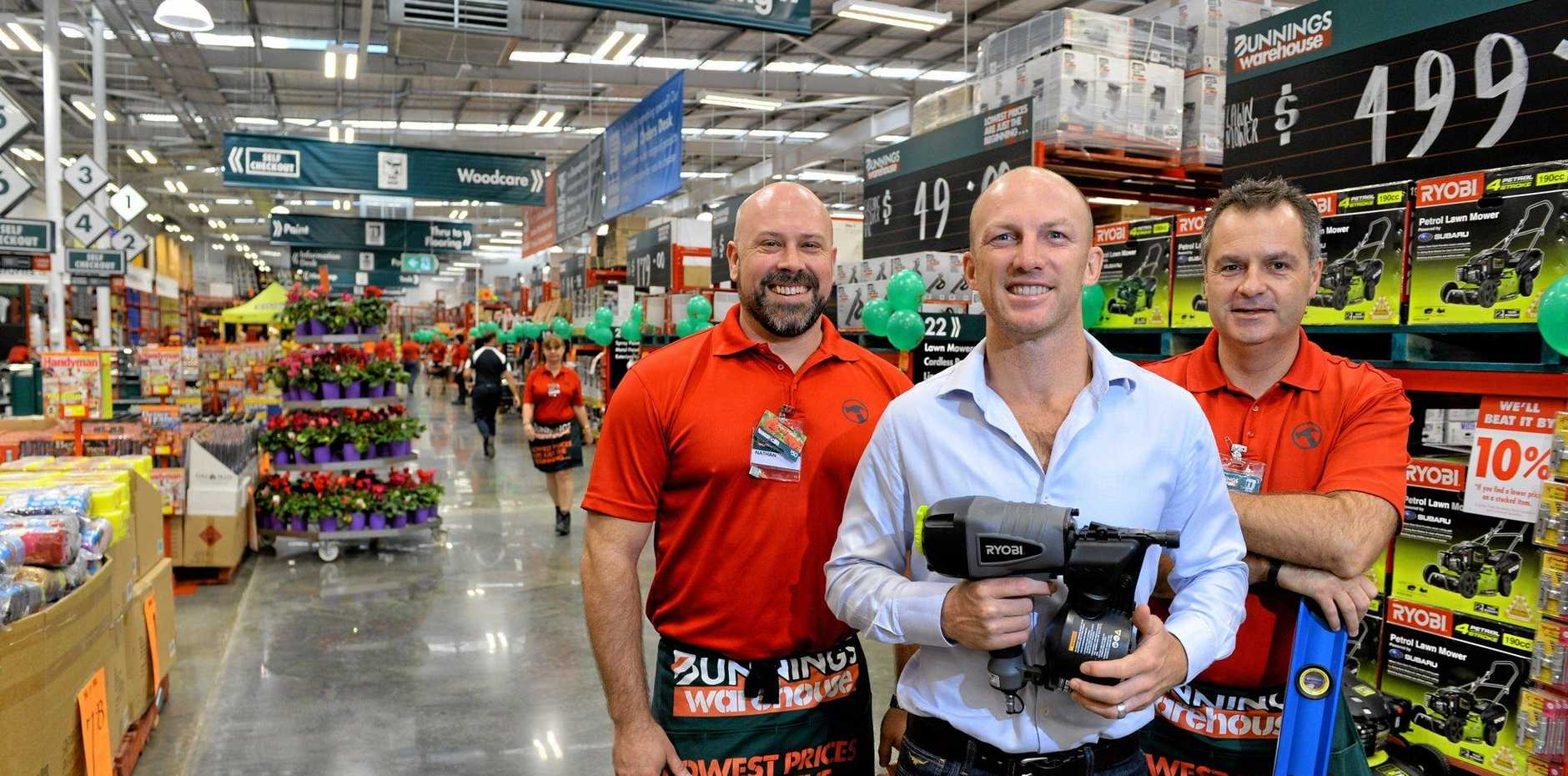 BIG NAME: Darren Lockyer dropped in to Bunnings Bundamba for the official opening of the store. He's pictured with complex manager Nathan Robley (left) and Bunnings managing director Mike Schneider
