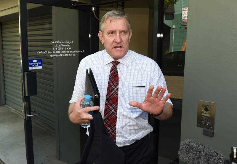 Federal member for Groom Ian Macfarlane leaves the the Liberal National Party's (LNP) Queensland headquarters in Brisbane, Monday, Dec. 14, 2015. The LNP has announced it will not support Macfarlane's move to The Nationals Party room in Canberra.