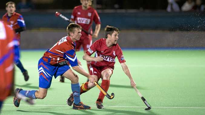 Norths Rangeville's Karl Harland and Red Lion's Craig Smith in A1 men Toowoomba Hockey Association preliminary final at Clyde Park, Saturday, September 5, 2015. Photo Kevin Farmer / The Chronicle