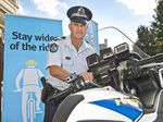 STAY SAFE: Darling Downs Crime Prevention Unit officer-in-charge Sergeant Scott McGrath  promoting road safety.  Thursday May 5 , 2016.