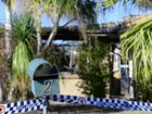Police at the scene of a fatal house fire in Ipswich.