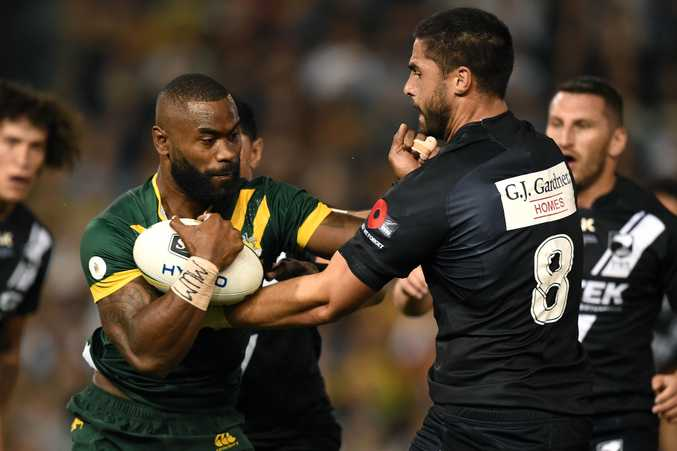 Semi Radradra is tackled by Jesse Bromwich of the Kiwis. Photo: AAP Image/Dan Himbrechts.