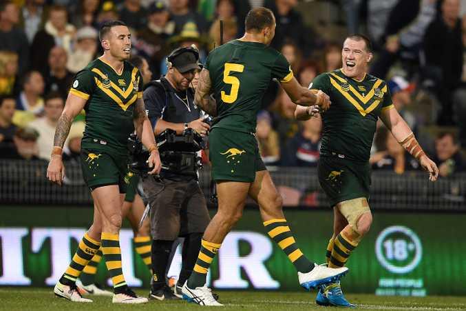 Paul Gallen (right) congratulates Kangaroos teammate Blake Ferguson (centre) after he scored a try  at Hunter Stadium. Photo: AAP Image/Dan Himbrechts