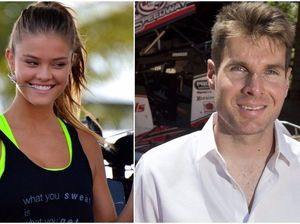 Racing champion in celebrity battle with swimsuit models