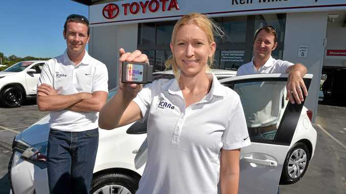 SAFETY FIRST: Ross Drummond, of Ken Mills Toyota with Angela and Jim Lee and their iCARe tracker.