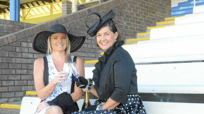 RACE READY: Grafton Shoppingworld marketing co-ordinator Chrystal Davies, left, and administration assistant Skye Howlett, get into the racing spirit ahead of this month's official launch of the 2016 July Racing Carnival.