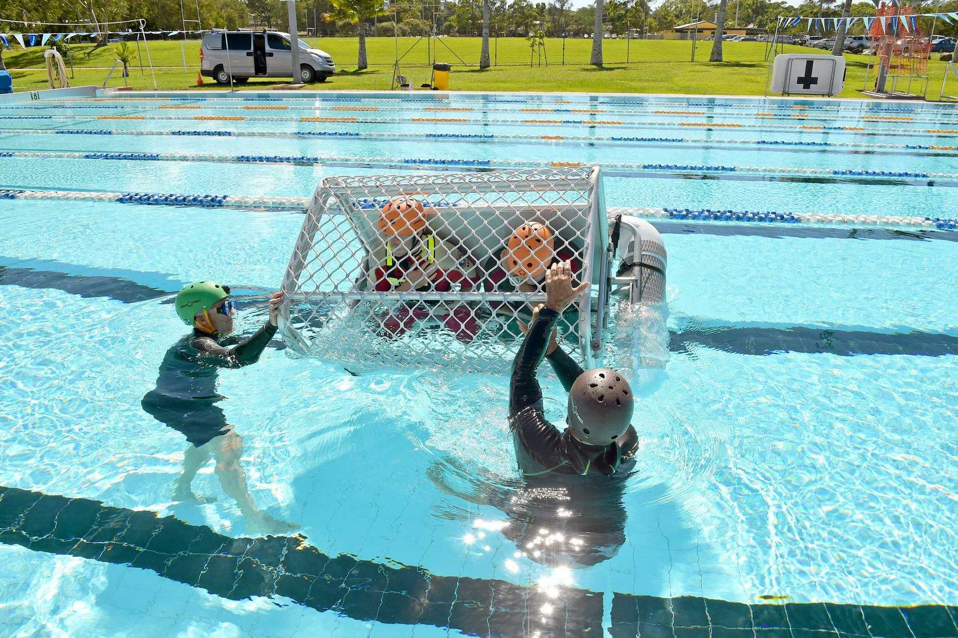 An elite group of SLSQ's Westpac Lifesaver Rescue Helicopter crewmembers complete helicopter underwater escape training (HUET) at the Caloundra Aquatic Centre.Jason Rice and Byron Tune from Diver Rescue Training take the crew members through the training.