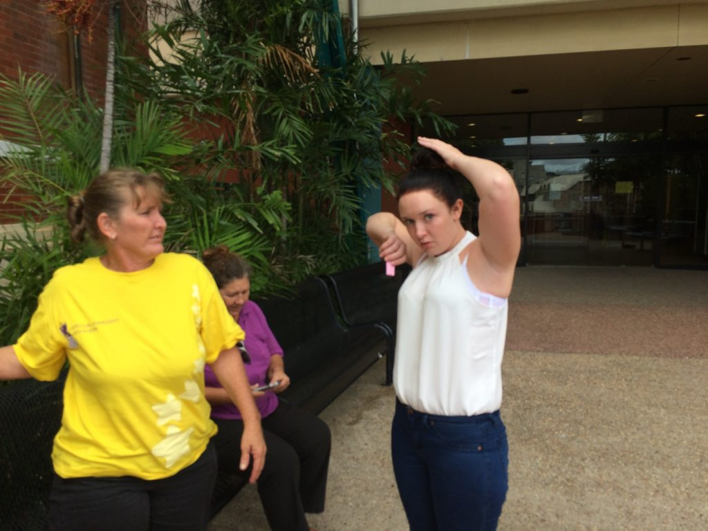 Shaina Lockyer (pictured in white) leaves Gladstone Courthouse. Photo Ross Irby / The Observer
