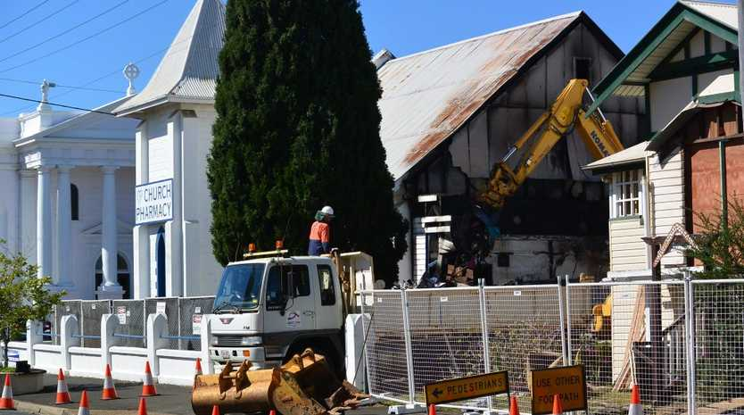 Church Pharmacy is being demolished after a fire ripped through the building. Photo: Craig Warhurst/News mail