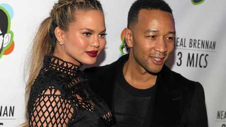 Chrissy Teigen and John Legend attend a Broadway show.