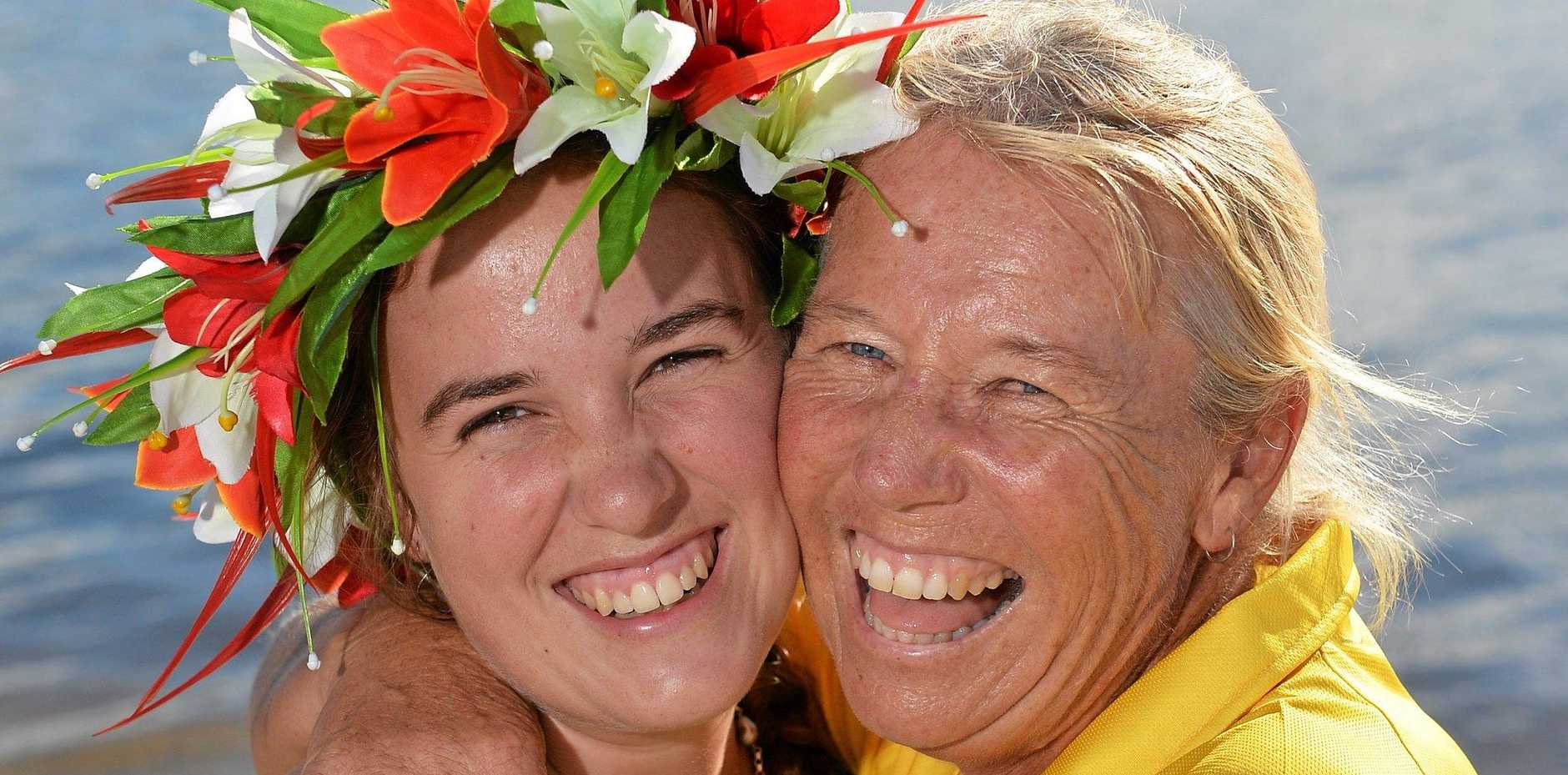FAMILY AFFAIR: Jenny Rasmussen and her daughter Rebecca embrace before the IVF Va'a World Sprint Championships at Lake Kawana starting today.