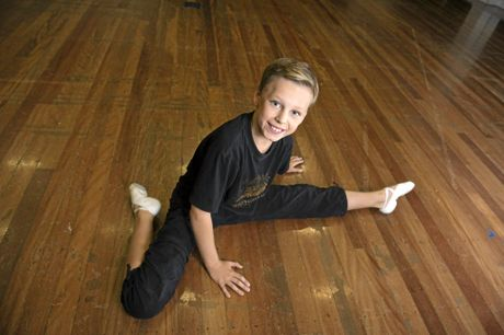 STRETCH IT OUT: Alfie Shacklock, 11 from Dance Centre Peregian Springs on the Sunshine Coast warms up to compete in the 123rd Queensland Eisteddfod at the Empire Theatre.